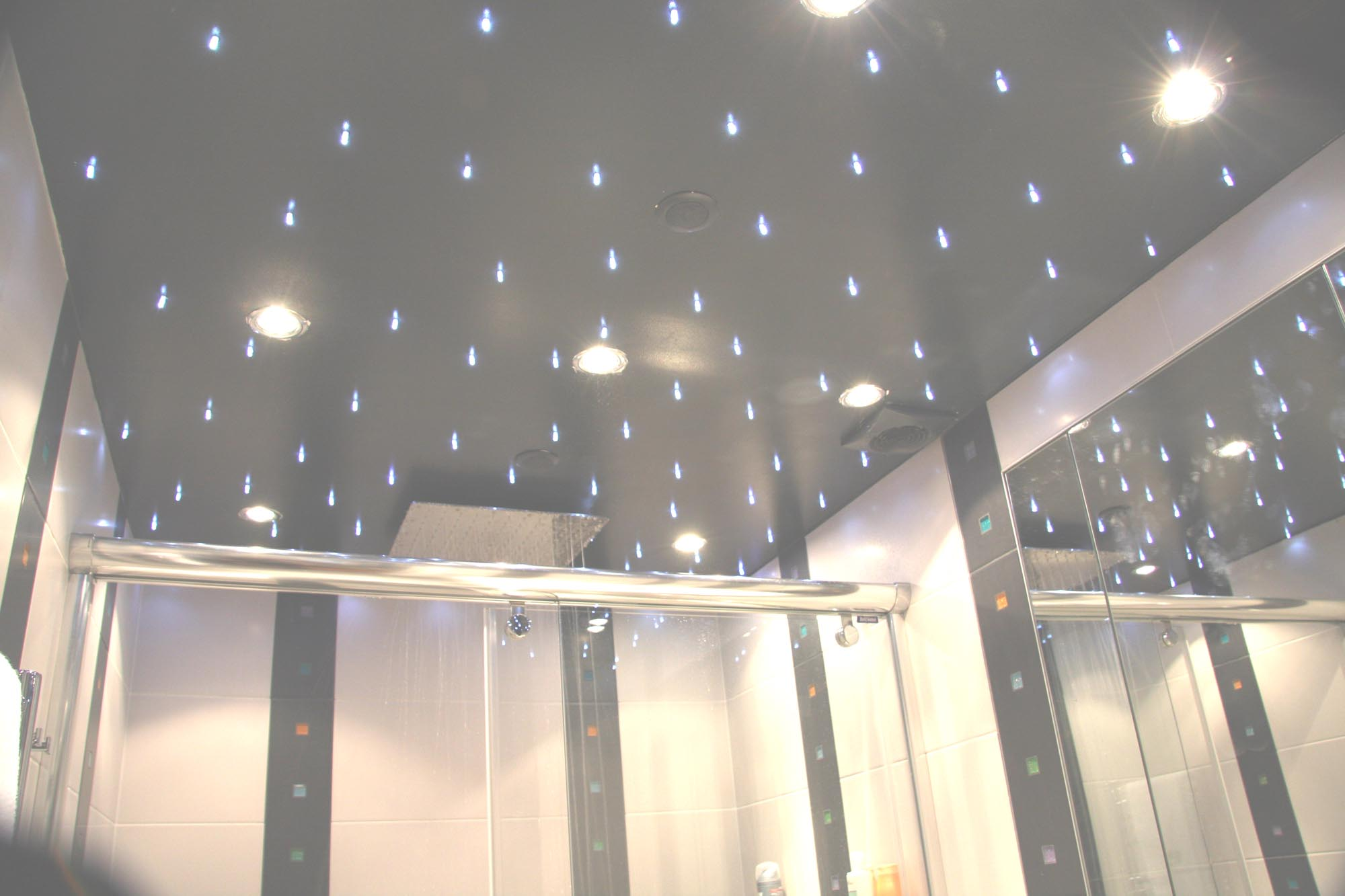 Starlit ceiling , pure white LEDs, bathroom, Paris / We worked closely with an interior designer to create a starlit effect across the bathroom ceiling, including above the shower